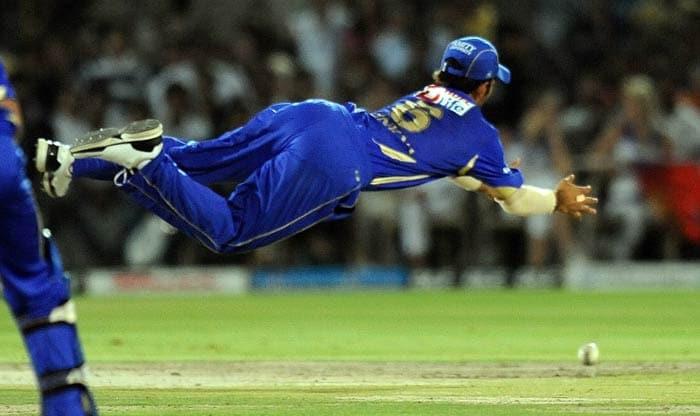 Ajinkya Rahane drops a catch of Chris Gayle during the IPL Twenty20 match between Rajasthan Royals and Royal Challengers Bangalore at the Sawai Mansingh Stadium in Jaipur. (AFP Photo)