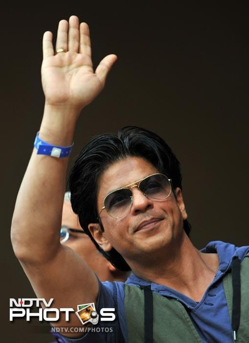 Bollywood actor and owner of Kolkata Knight Riders team Shah Rukh Khan waves to the crowd during the IPL Twenty20 cricket match between Royal Challengers Bangalore and Kolkata Knight Riders at the M. Chinnaswamy Stadium in Bangalore. (AFP Photo)