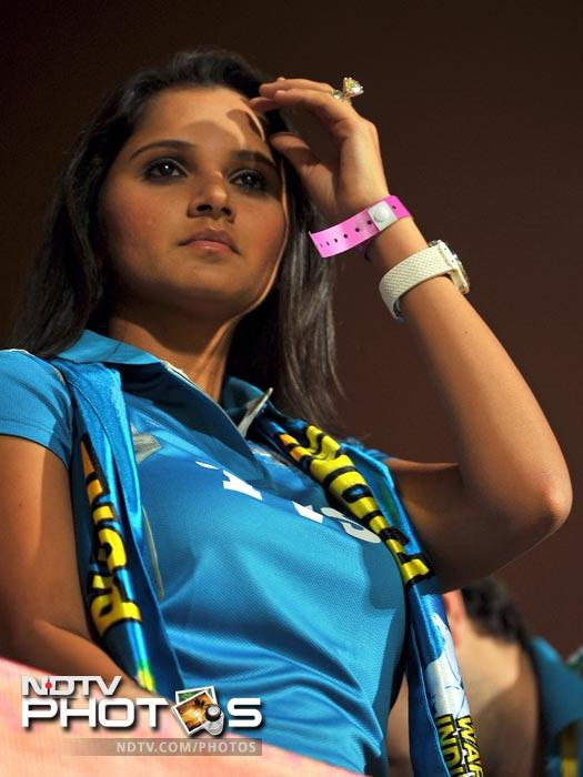 Sania Mirza watches from the stands prior to the start of the IPL Twenty20 match between Royal Challengers Bangalore and Pune Warriors at the M. Chinnaswamy Stadium in Bangalore. (AFP Photo)