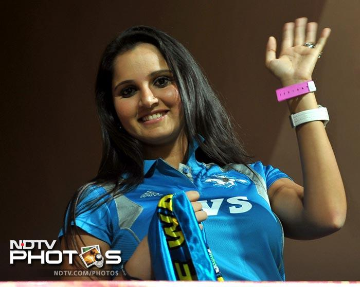 Sania Mirza waves to photographers from the stands prior to the start of the IPL Twenty20 match between Royal Challengers Bangalore and Pune Warriors at the M. Chinnaswamy Stadium in Bangalore. (AFP Photo)