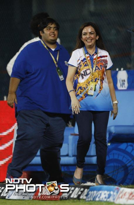 Mumbai Indians' team owner Nita Ambani celebrates with her son their team's win in the IPL match against Chennai Super Kings in Chennai. (AP Photo)