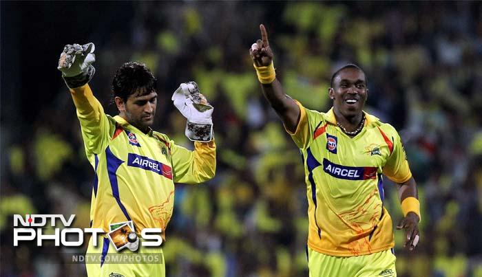 Chennai Super Kings bowler Dwayne Bravo celebrates with his skipper MS Dhoni after taking the wicket of Pune Warriors batsman Angelo Mathews during the IPL 5 match in Chennai. (PTI Photo)
