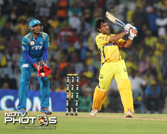 Chennai Super Kings captain MS Dhoni hooks for a six off Marlon Samuels of Pune Warriors during the IPL Twenty20 cricket match at the M.A.Chidambaram Stadium in Chennai. (AFP Photo)