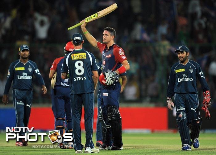 Kevin Pietersen celebrates after scoring a century (100 runs) during the IPL Twenty20 match between Deccan Chargers and Delhi Daredevils at the Feroz Shah Kotla stadium in New Delhi. (AFP Photo)