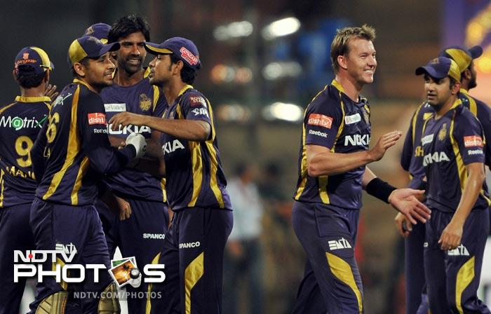 Kolkata Knight Riders celebrate their victory over Royal Challengers Bangalore during the IPL Twenty20 match at the M. Chinnaswamy Stadium in Bangalore. (AFP Photo)