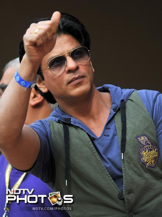 Bollywood actor and owner of Kolkata Knight Riders team Shah Rukh Khan greets the crowd during the IPL Twenty20 match between Royal Challengers Bangalore and Kolkata Knight Riders at the M. Chinnaswamy Stadium in Bangalore. (AFP Photo)