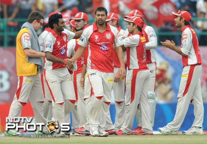 Praveen Kumar celebrates with his teammates after taking the wicket of Murali Vijay during the IPL Twenty20 match between Kings XI Punjab and Chennai Super King at Himachal Pradesh Cricket stadium in Dharamsala. (AFP Photo)