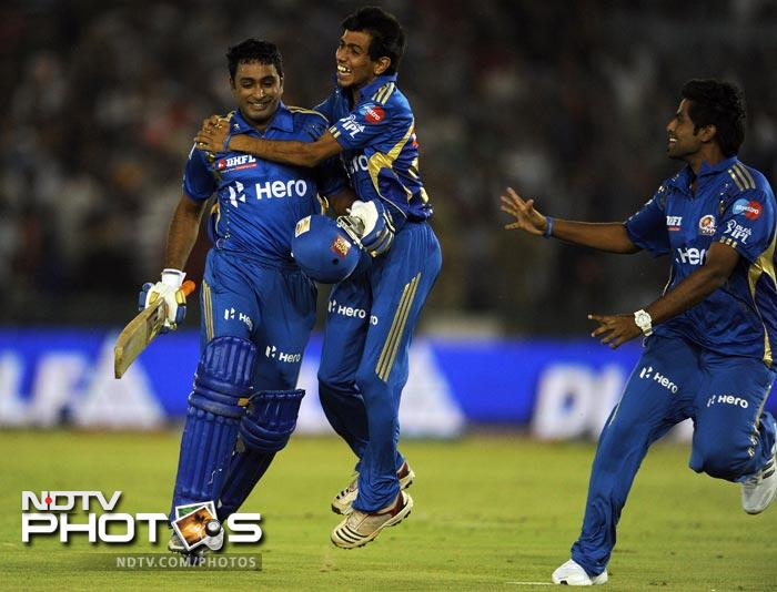 Ambati Rayudu celebrates his team's victory with teammates after the IPL Twenty20 match between Kings XI Punjab and Mumbai Indians at PCA Stadium in Mohali. (AFP Photo)