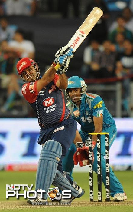 Virender Sehwag plays a shot during the IPL Twenty20 match between Pune Warriors India and Delhi Daredevils at the Sahara Stadium in Pune. (AFP Photo)