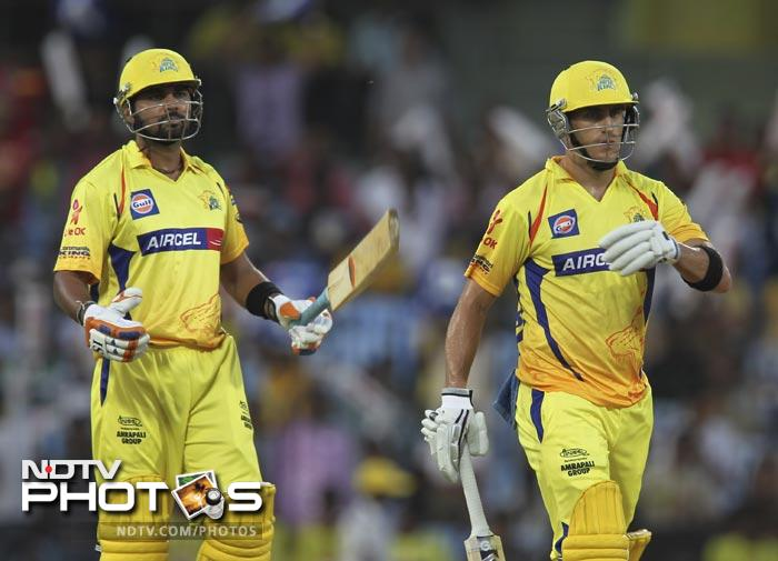 Murali Vijay and Faf du Plessis gesture during the IPL Twenty20 match between Chennai Super Kings and Royal Challengers Bangalore at the M.A. Chidambaram Stadium in Chennai. (AFP Photo)