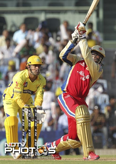 Chris Gayle hits a six during the IPL Twenty20 match between Chennai Super Kings and Royal Challengers Bangalore at the M.A. Chidambaram Stadium in Chennai. (AFP Photo)