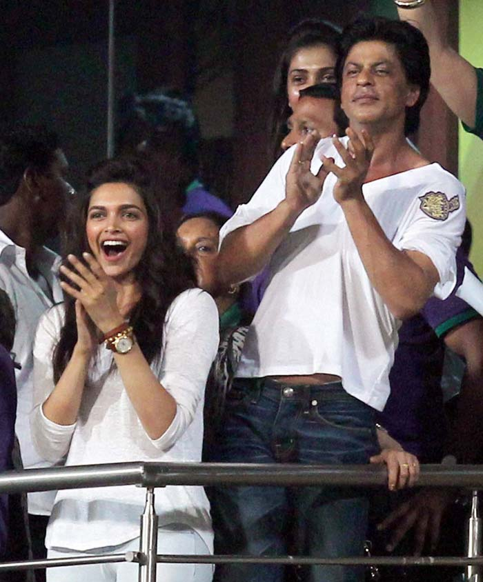 Deepika Padukone is joyous as she cheers on the Kolkata Knight Riders with Shah Rukh Khan in the background. (PTI image)