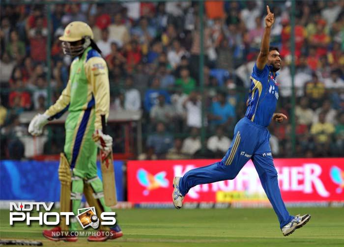 Munaf Patel is seen here celebrating as he got the early wicket of the dangerous Chris Gayle to peg back Bangalore. (PHOTOS AFP)