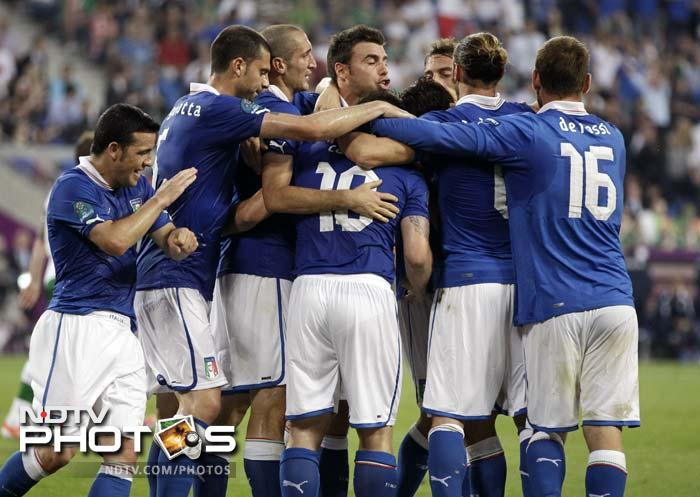 Italy qualified for the quarterfinals of Euro 2012 after Antonio Cassano and Mario Balotelli scored in each half in a tense 2-0 victory over Ireland. (All AFP and AP Images)