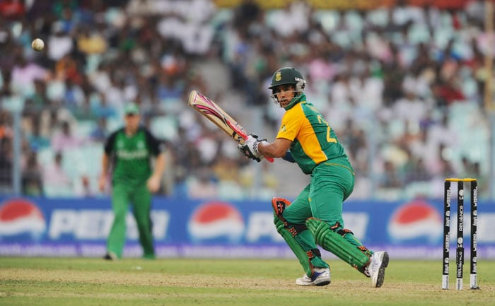 South African batsman JP Duminy eyes the ball as he plays a shot during the Group B match. (AFP Photo)