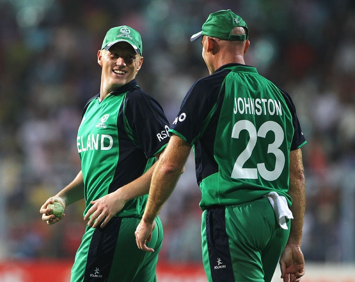 Trent Johnston of Ireland congratulates Kevin O'Brien, after he caught JP Duminy for 99 runs. (Getty Images)