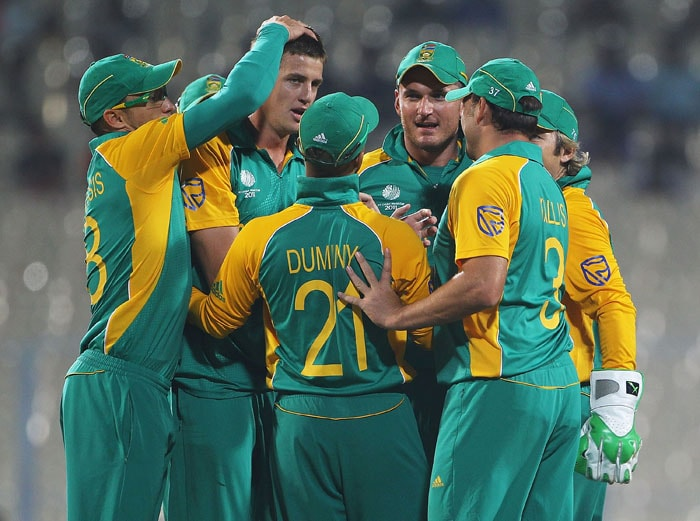 Morne Morkel of South Africa is congratulated on the wicket of William Porterfield of Ireland after he was caught by Graeme Smith. (Getty Images)