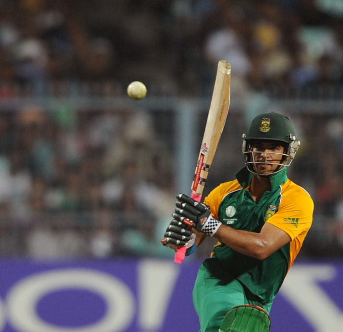 South African batsman JP Duminy keeps his eyes on the ball after playing a shot. (AFP Photo)