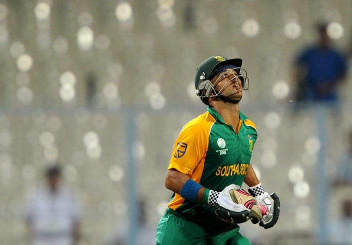 South African batsman JP Duminy keeps his eyes on the ball after playing a shot during the Group B match. (AFP Photo)