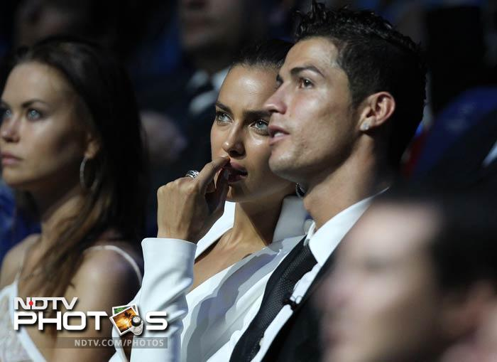 Both Irina and Ronaldo concentrate on the proceedings on the stage.