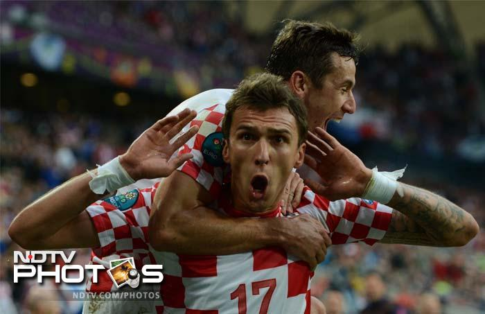 Mario Mandzukic landed a 'near death' blow to Italy as their chances to qualify to the next stage look rather bleak now. (AFP Photo)