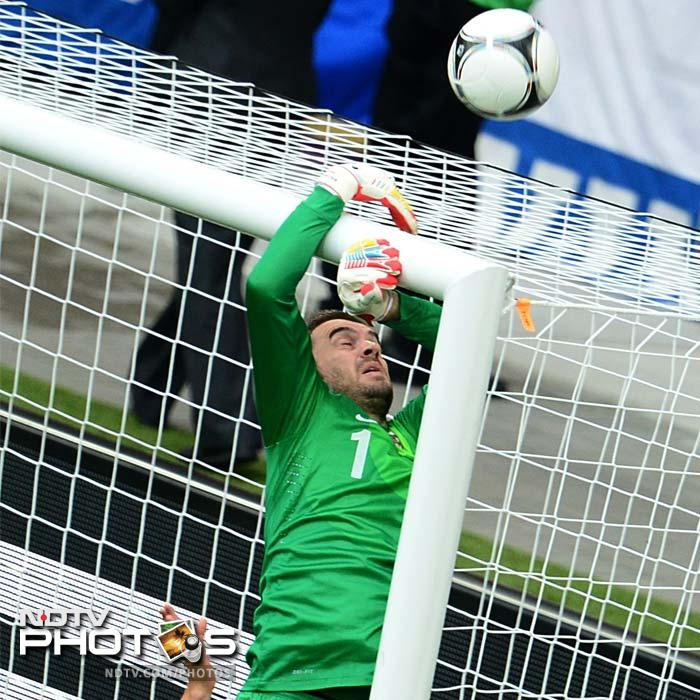 Italy launched attacks after attacks on Croatian goal. Croatian goalkeeper Stipe Pletikosa jumps to protect his goal during the match. (AFP PHOTO/ DIMITAR DILKOFF)