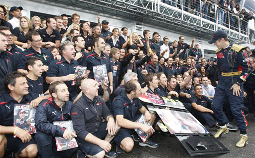 Toro Rosso driver Sebastian Vettel of Germany celebrates with team members after winning the Formula One Grand Prix in Monza, Italy on September 14, 2008.