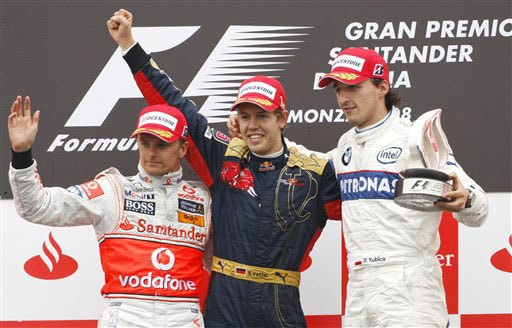 Toro Rosso driver Sebastian Vettel of Germany, winner, center, second placed McLaren Mercedes driver Heikki Kovalainen, of Finland, left, and BMW Sauber driver Robert Kubica, of Poland, third placed, celebrate on the podium of the Formula One Grand Prix, in Monza, Italy on September 14, 2008.