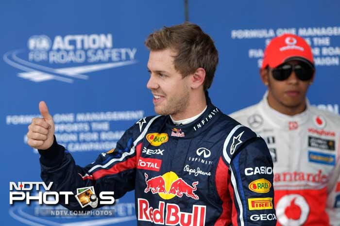 German ace Sebastian Vettel snatched pole position for the Japanese Grand Prix in a thrilling qualifying session on Saturday as he closed in on back-to-back Formula One world titles. (ALL AP IMAGES)