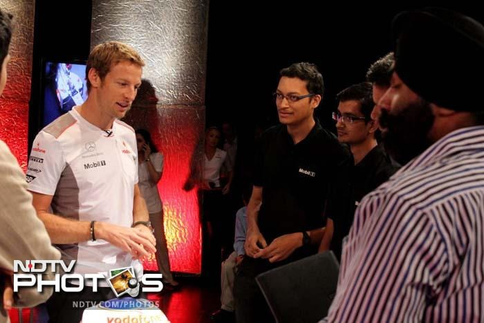 The 32-year-old racer is seen here talking to winners of the contest. Fans were asked a question about the driver and five winners were picked to be part of NDTV's special show with him.