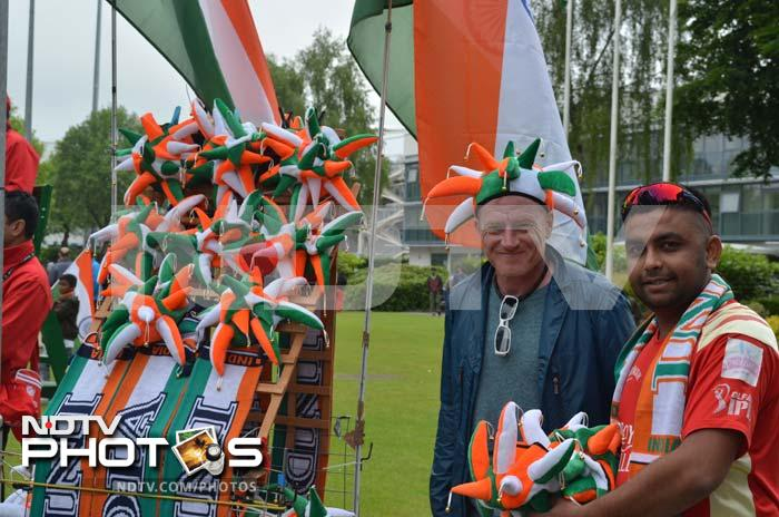 A souvenir seller showcasing the supporter hats for Indian fans outside the Swalec Stadium.