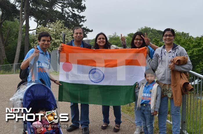 An Indian family posing with the tricolour as they look eager for the start of India vs South Africa Champions Trophy opening tie in Cardiff.