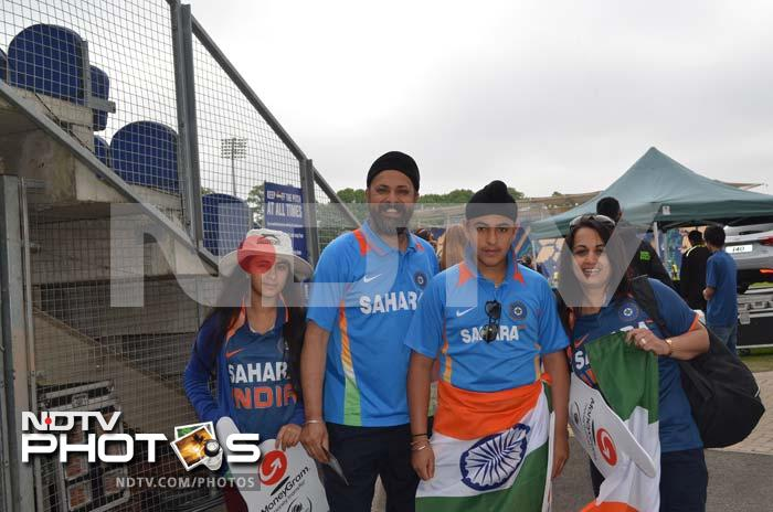 Eager fans in Cardiff pose with the tricolour, showcasing their love for Team India.
