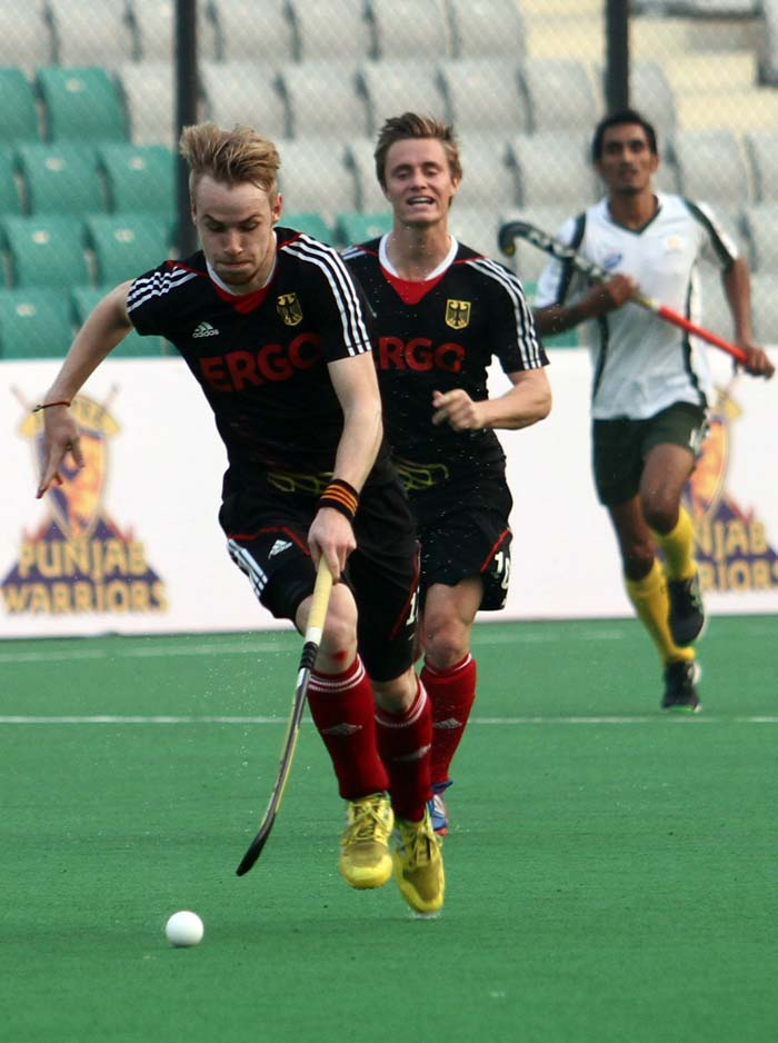 In other matches on Saturday, defending champions Germany thrashed Pakistan 6-1 thanks to a hat-trick by Christopher Ruhr (front).