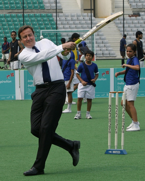 Kapil Dev, India's only world cup wining captain, sent down a few balls to the British premier when he visited the National Stadium to have a look at the Commonwealth Games venues. National stadium, which hosted the hockey World Cup earlier this year, is a venue for the CWG hockey event also. (AP Photo)