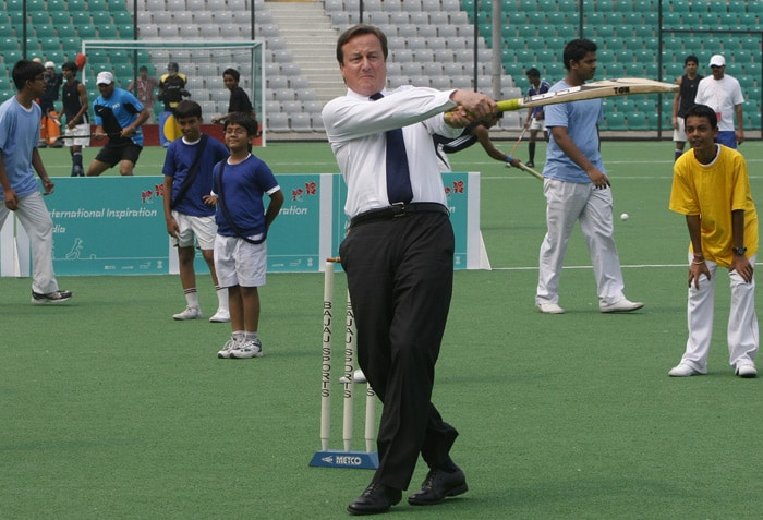 """This is the second time in just two days that Cameron has referred to Indian sporting icons. Addressing a gathering at Infosys on Wednesday, Cameron said, """" Whether its watching Shak Rukh Khan, eating the same food, speaking the same language - and of course watching the same sport. Sachin Tendulkar, the little master, is so talented that wherever you are from you cannot help but admire as he hits another century."""" (AP Photo)"""