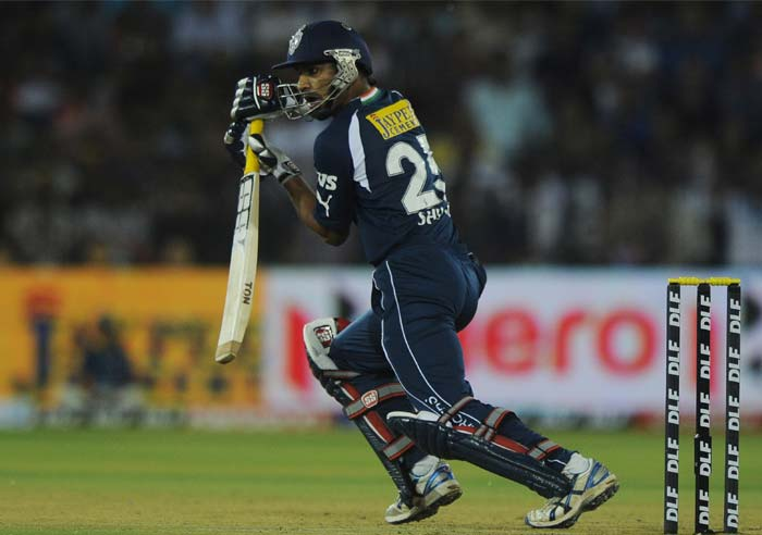 Shikhar Dhawan in action for the hosts, en route to his 50 off 50 balls. (AFP PHOTO/Dibyangshu SARKAR)