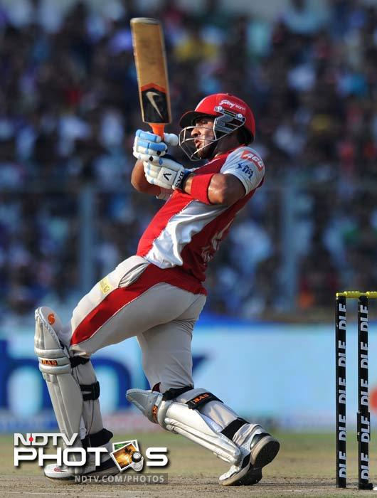 Mandeep Singh at the other end was solid and his 34-ball 38 was an example of his determination, at least on the day against KKR. (AFP PHOTO/Dibyangshu SARKAR)