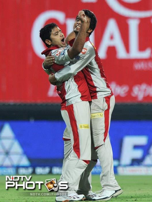 It was all in vain though Piyush Chawla (l) struck at the right time and took three from the match. The game was taken to the final over but the hosts could not go past the required target. (AFP PHOTO/Dibyangshu SARKAR)