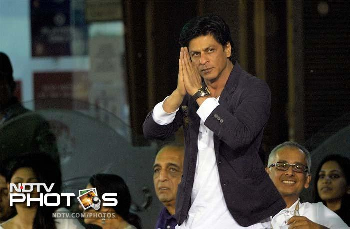 Kolkata's co-owner Shah Rukh Khan looked quite pleased with the eventual target set for his team at 125. (AFP PHOTO/ PRAKASH SINGH)