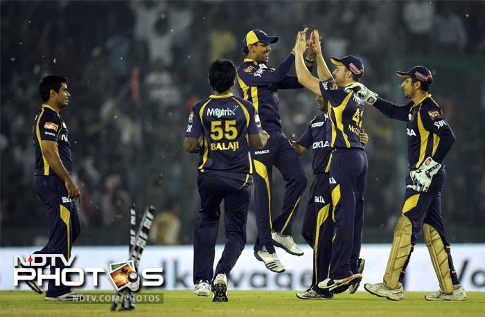 If revenge is a dish best served cold, Adam Gilchrist's side were left positively shivering as Kolkata Knight Riders avenged their defeat at the Eden Gardens, with style, pomp and two points. A look at the proceedings. (AFP PHOTO/ PRAKASH SINGH)