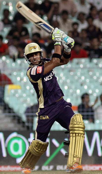 Kolkata Knight Riders player Manoj Tiwary plays a shot during the IPL Twenty20 match against Deccan Chargers at the Eden Gardens in Kolkat. (AFP PHOTO)