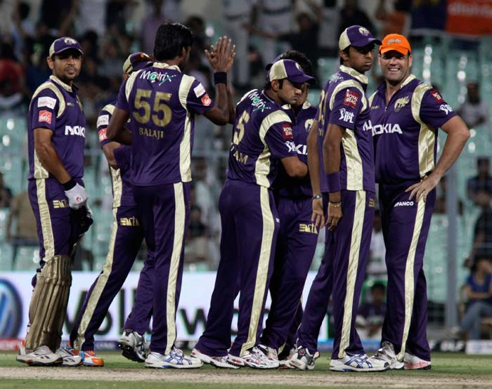 Kolkata Knight Riders players celebrate after the dissmissal of Deccan Chargers opener Shikhar Dhawan during the IPL Twenty20 match at the Eden Gardens in Kolkata. (AFP PHOTO )