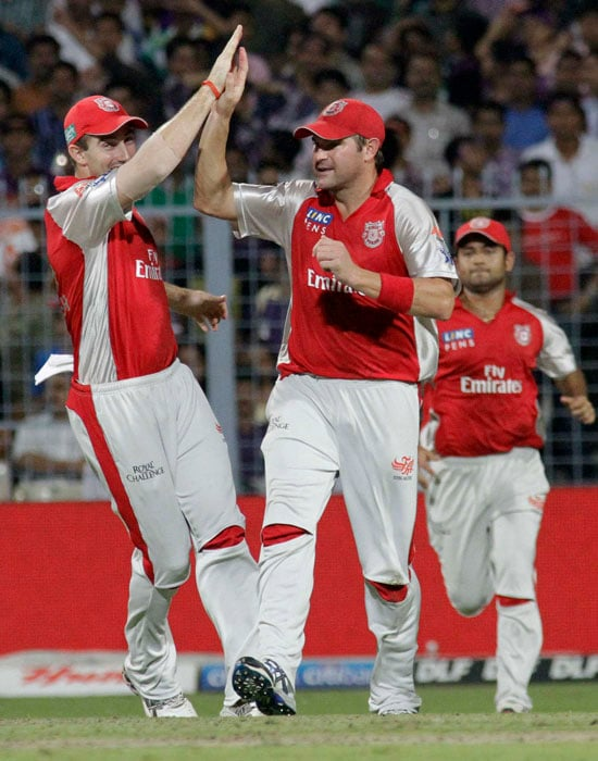 Kings XI Punjab Ryan Harris, center, celebrates with teammates after taking a catch to dismiss Kolkata Knight Riders' Eoin Morgan during an Indian Premier League cricket match at the Eden Gardens Stadium. (AP Photo)