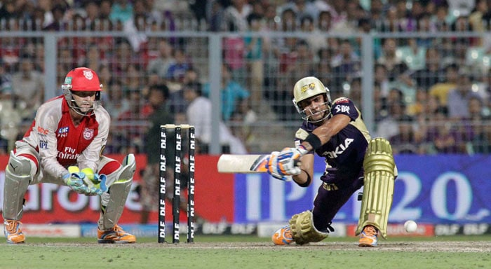 Kolkata Knight Riders' Manoj Tiwary hits a shot during the Indian Premier League cricket match against Kings XI Punjab at the Eden Gardens Stadium. (AP Photo