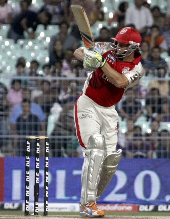 Kings XI Punjab captain Adam Gilchrist plays a shot during the IPL Twenty20 cricket match against Kolkata Knight Riders at the Eden Gardens Stadium. (AFP PHOTO)