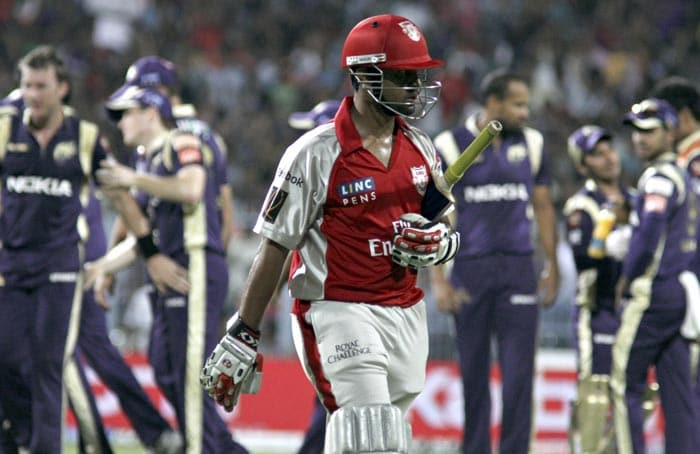 Kings XI Punjab batsman Paul Valthaty walks back to the pavilion following his dismissal during the IPL Twenty20 cricket match against Kolkata Knight Riders at the Eden Gardens Stadium. (AFP PHOTO)
