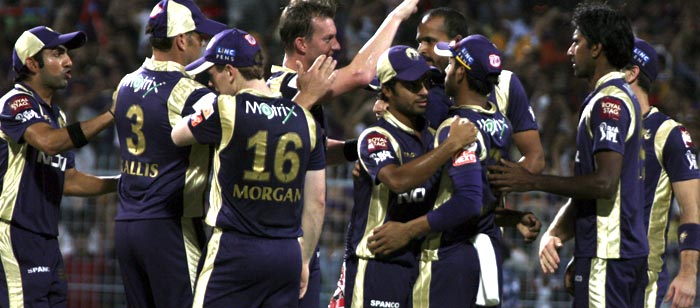 Kolkata Knight Riders team celebrates the wickets of Kings XI Punjab batsman Paul Valthaty during the IPL Twenty20 cricket match at the Eden Gardens Stadium. (AFP PHOTO)