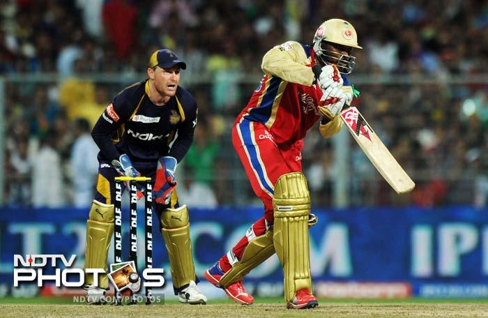 Royal Challengers Bangalore batsman Chris Gayle is watched by Kolkata Knight Riders wicketkeeper Brendon McCullum as he plays a shot during the IPL Twenty20 cricket match at the Eden Gardens in Kolkata. (AFP PHOTO/Dibyangshu SARKAR)