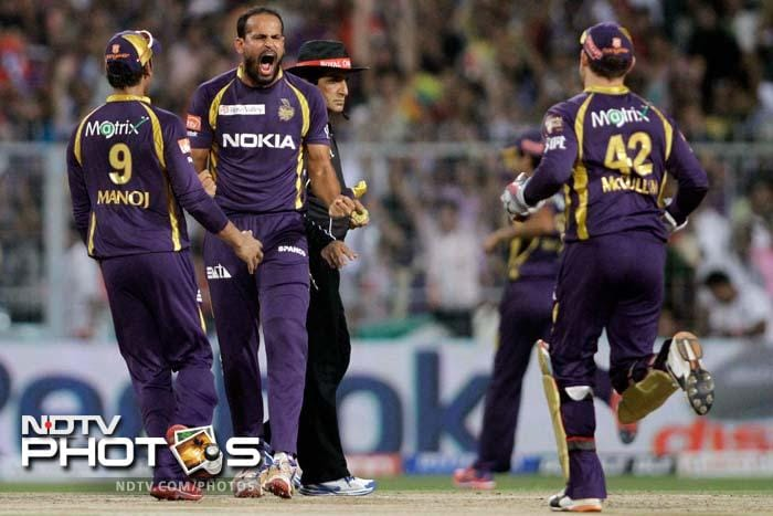 Kolkata Knight Riders bowler Yusuf Pathan, second left, reacts after taking the wicket of Royal Challengers Bangalore's Tillakaratne Dilshan, unseen, during the Indian Premier League (IPL) cricket match in Kolkata. (AP Photo/Bikas Das)